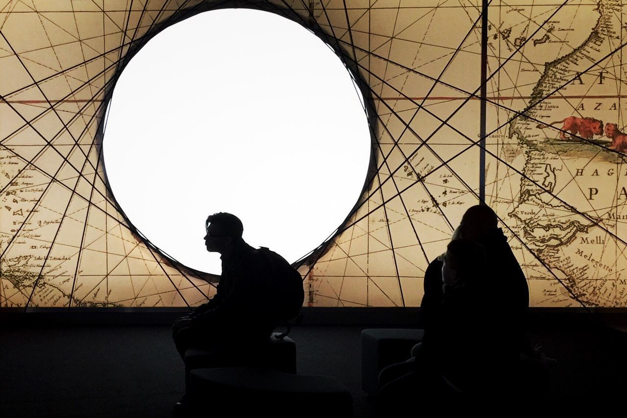 Silhouette People Sitting On Seat At Illuminated Vasa Museum