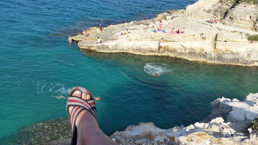 holidays in Salento Feel The Journey Cliff Dive EyeEm Best Sellers Idyllic Leisure Activity Lifestyles Nature Relaxation Rippled Rock Rock - Object Rock Formation Scenics Sea Summer Tan Tourism Tourist Tranquil Scene Tranquility Turquoise Colored Vacations Water