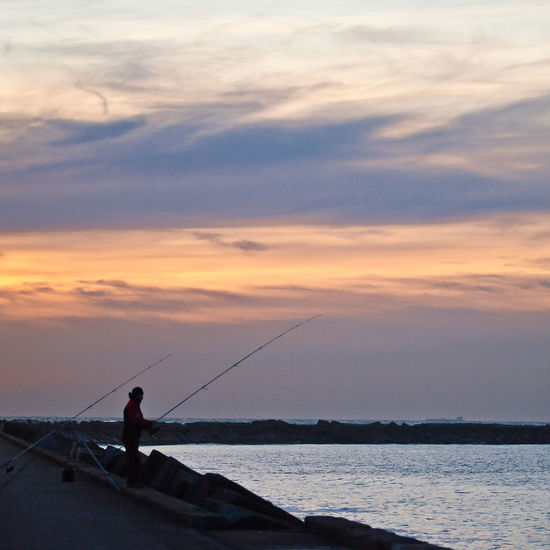 Sunset_collection Activity Beauty In Nature Cloud - Sky Fisherman Fishing Fishing Rod Horizon Over Water Leisure Activity Nature One Person Orange Color Outdoors Rod Scenics - Nature Seascape Sky Sunset Tranquility