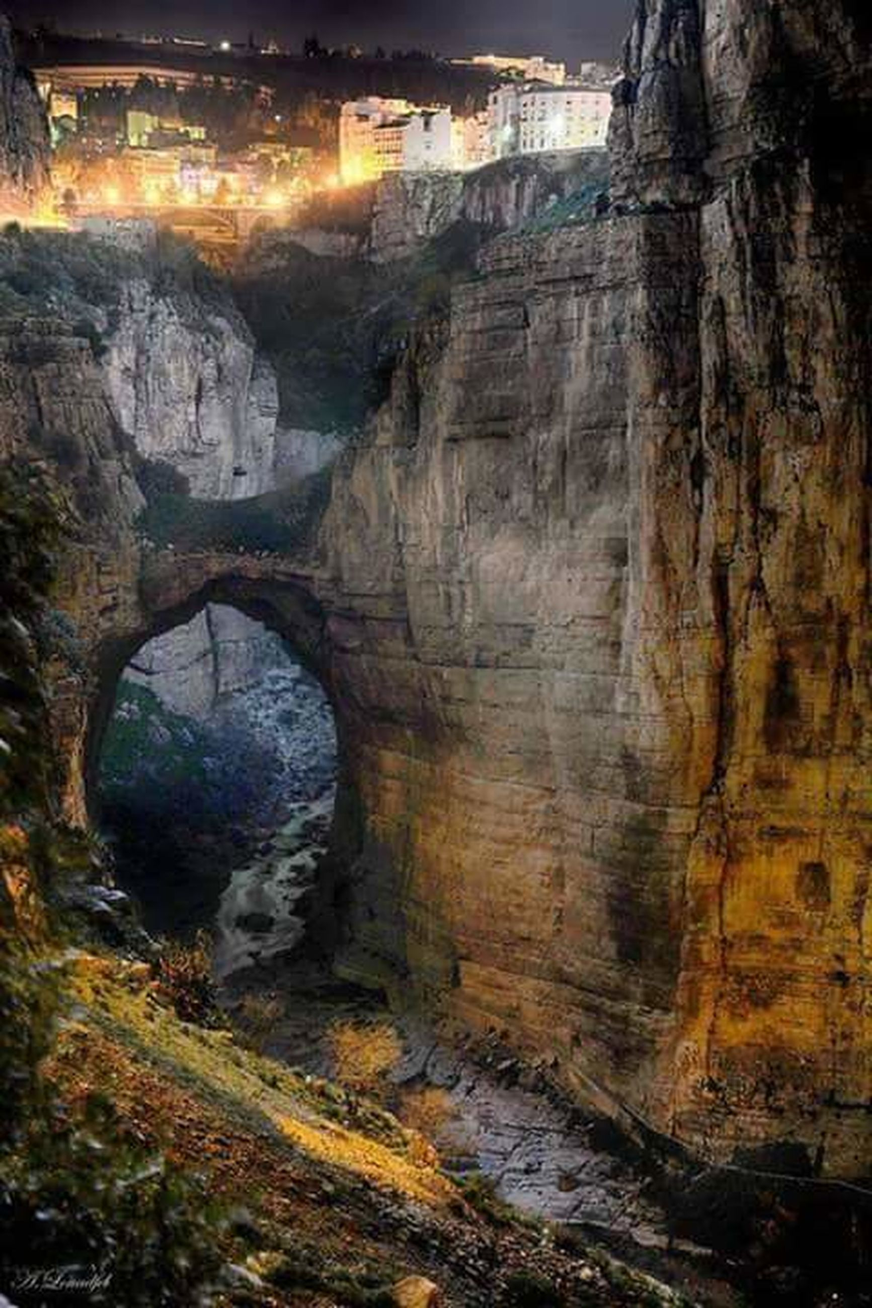 water, built structure, architecture, bridge - man made structure, scenics, tranquil scene, river, arch bridge, tranquility, tunnel, arch, rock formation, nature, outdoors, day, beauty in nature, non-urban scene, physical geography, canal, engineering, curve, remote, bridge, archway, no people