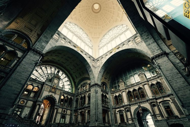 Inside the Central Train Station in Antwerp Antwerpen March 2019 Touristic Attraction Famous Building Antwerp Train Station Train Station Historical Building Indoors  Architecture Built Structure Low Angle View Arch Building Exterior Building The Past History Travel Destinations Architectural Column Architecture And Art No People Ceiling Ornate