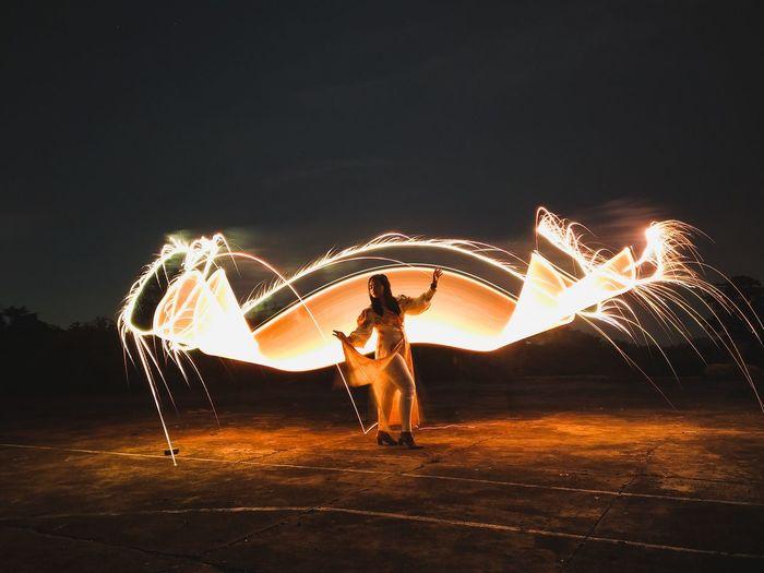 View of illuminated ferris wheel at night