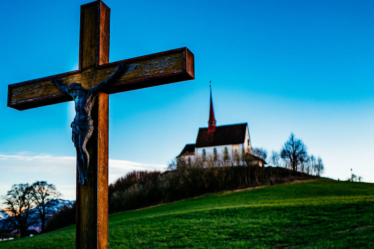 Architecture Blue Building Exterior Built Structure Church Clear Sky Cross Field Gormund Grass Grassy Kapelle Low Angle View Old Place Of Worship Religion Rural Scene Sky Spirituality Tree