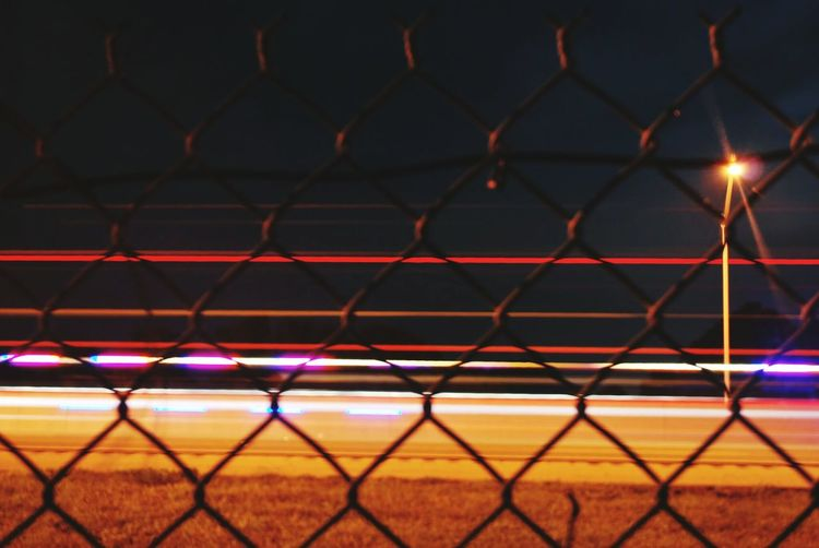 Safety Chainlink Fence Tranquil Scene Backgrounds Idyllic Majestic Highway Travel Photography Traveling Open Shutter Long Exposure Fence Notes From The Underground No People Notes From Underground Florida Open Edit