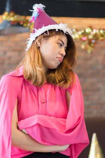 Sad young woman at christmas party