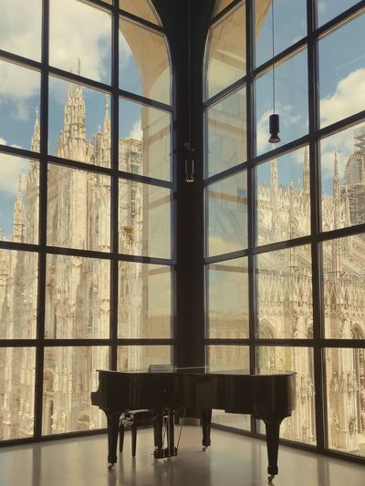 Interior of silhouette building against sky