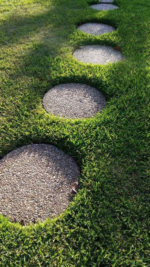 Stepping stones on grassy field