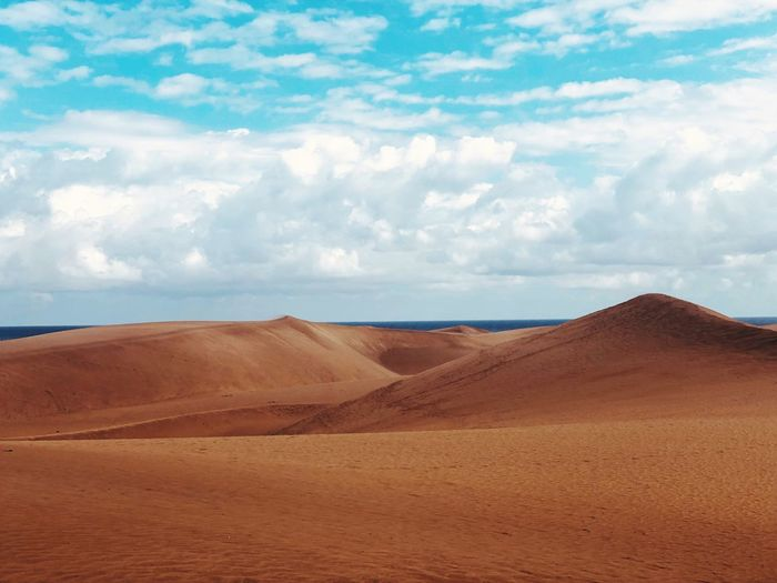 Sand Dune Land Cloud - Sky Sand Scenics - Nature Landscape Sky Desert Environment Beauty In Nature Climate Tranquil Scene Nature Tranquility Sand Dune Non-urban Scene Arid Climate No People Day Outdoors Travel Destinations