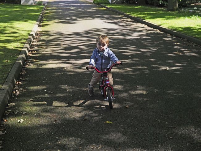 Shadows Bicycle Boys Casual Clothing Child Childhood Day Full Length Innocence Leisure Activity Males  Nature Offspring One Person Outdoors Real People Ride Riding Shadow Transportation
