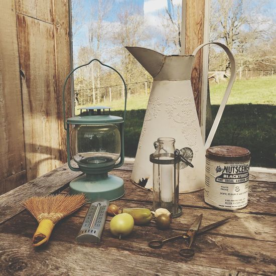 Still life from a greenhouse No People Table Day Indoors  Tomatoes Jug Wood - Material Box Metalbox Tree Close-up Freshness Candle Termometer Broom Garden Shabby Chic Home Decor Decoration Gardening Garden Decor Greenhouse Decor