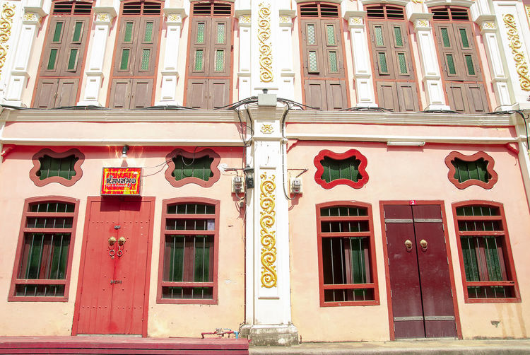 The image of the old Sino Portuguese architecture shows the design of the window from China, which is located in Phuket, Thailand. Architecture Phuket,Thailand Sunlight Architecture Art And Craft Building Building Exterior Built Structure China City Communication Day Decoration Decorative Art Door Entrance Exterior History Low Angle View No People Old Buildings Outdoors Represents Sino-portuguese Architecture Window