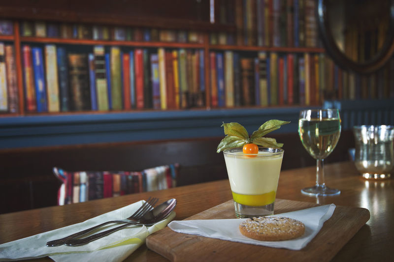 Real food dessert Dessert Real Food Alcohol Book Bookshelf Close-up Day Drink Drinking Glass Food Food And Drink Fresh Food Freshness Healthy Eating Indoors  Lemon No People Orange Juice  Plate Ready-to-eat Refreshment Restaurant Table Wine Wineglass