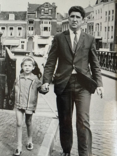 IPS2016Street Old Times 1969 My Dad And I When I Was Young Going To Market A picture my mom took of me and my Dad around 1969 dressed up to buy some fish at the market in Middelburg, Zeeland, The Netherlands Photographic Memory