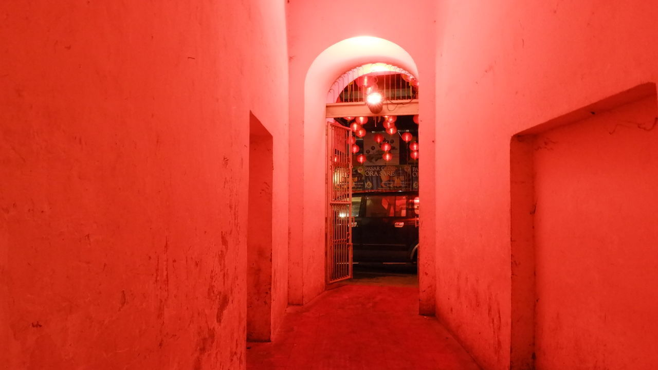 ILLUMINATED ENTRANCE OF BUILDING DURING RED WALL