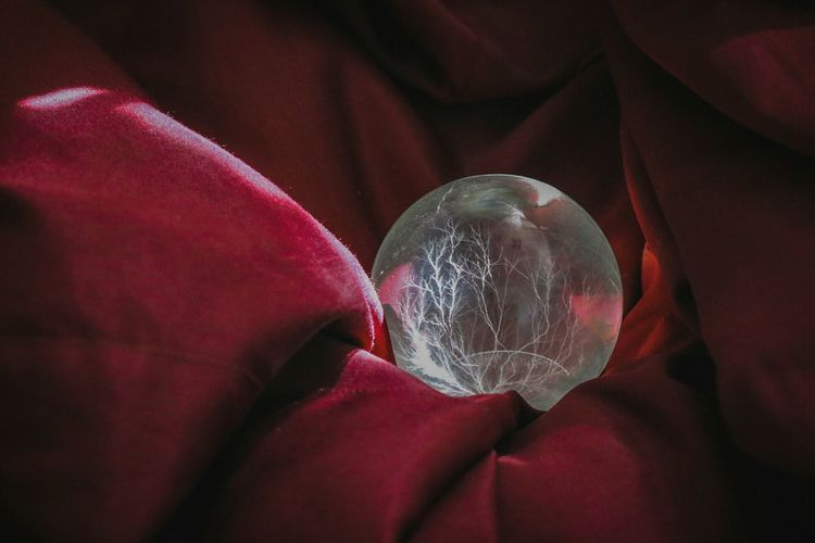 Crystal Ball On Red Fabric