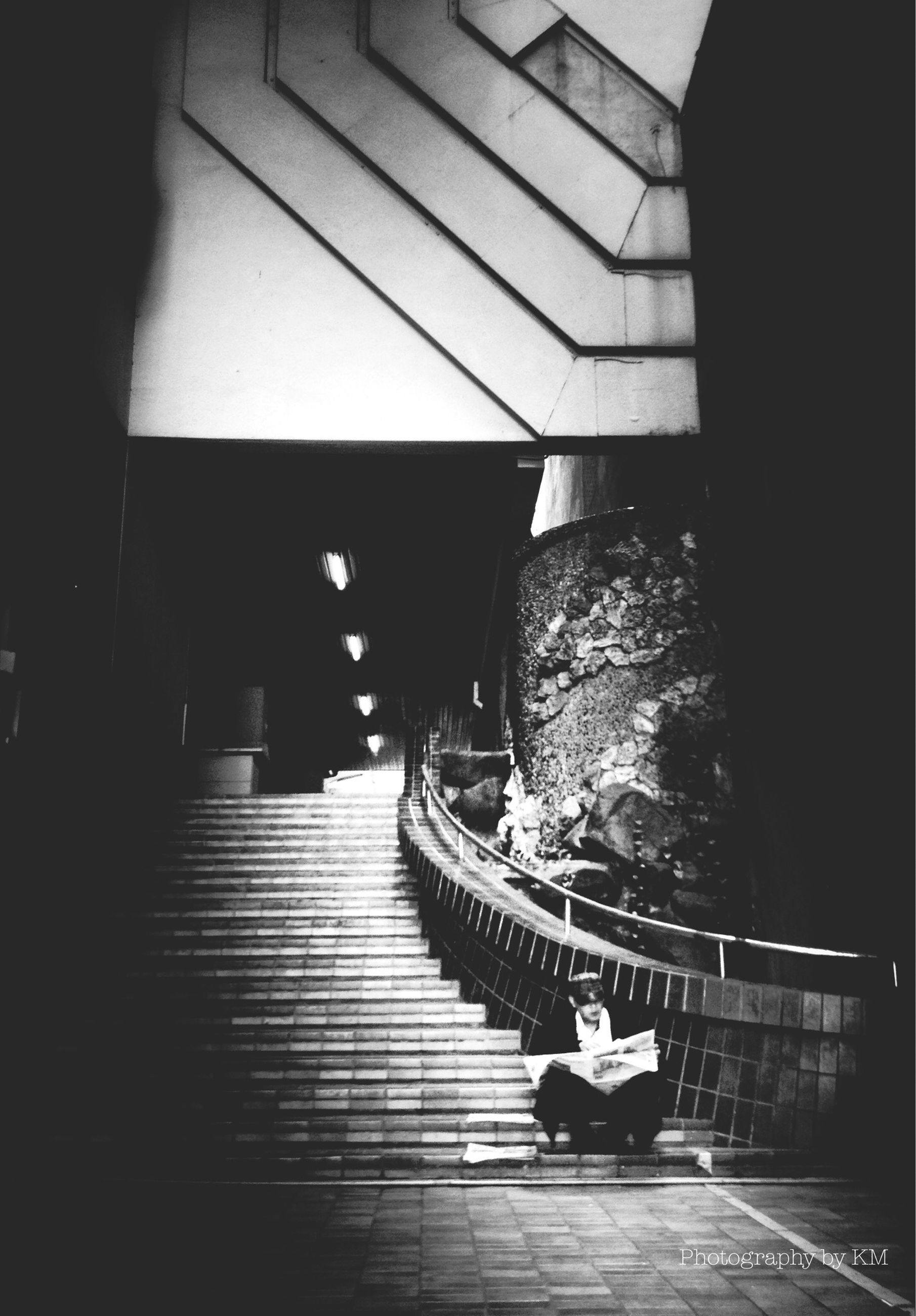 architecture, built structure, steps, full length, men, steps and staircases, walking, lifestyles, building exterior, staircase, person, indoors, high angle view, the way forward, railing, rear view, night
