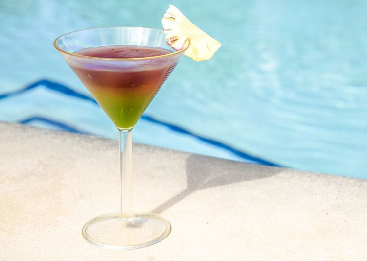 Cocktail at the Pool Poolside Pool Cocktail Refreshment Drink Food And Drink Cocktail Alcohol Glass Martini Glass Food Drinking Glass Table Freshness Fruit No People Household Equipment Swimming Pool Pool Shadow Healthy Eating Day Martini