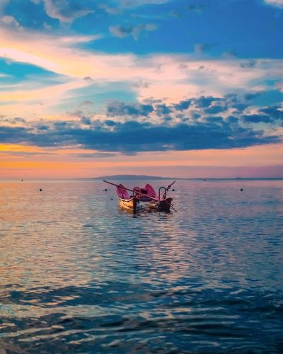 Red rescue boat at sunset Lifeguard  Rows Wooden Boat Pattino Boat Red Seascape Water Sky Cloud - Sky Sea Nautical Vessel Sunset Transportation Beauty In Nature Mode Of Transportation Waterfront Horizon Over Water Horizon Tranquility Outdoors
