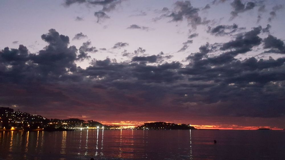 Sunset, beach and city lights Water Sunset Night Sea Cloud - Sky Reflection No People Travel Destinations Baiona The Week On EyeEm
