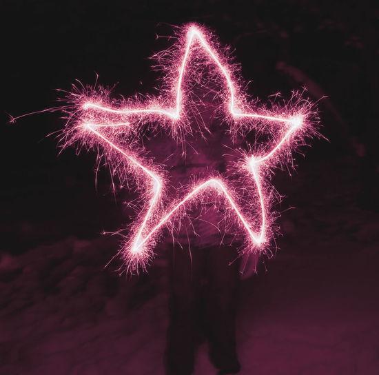 Close-up of illuminated firework display at night