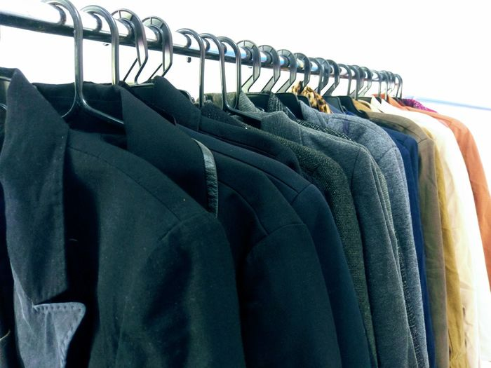 Midsection of clothes hanging on rack in store