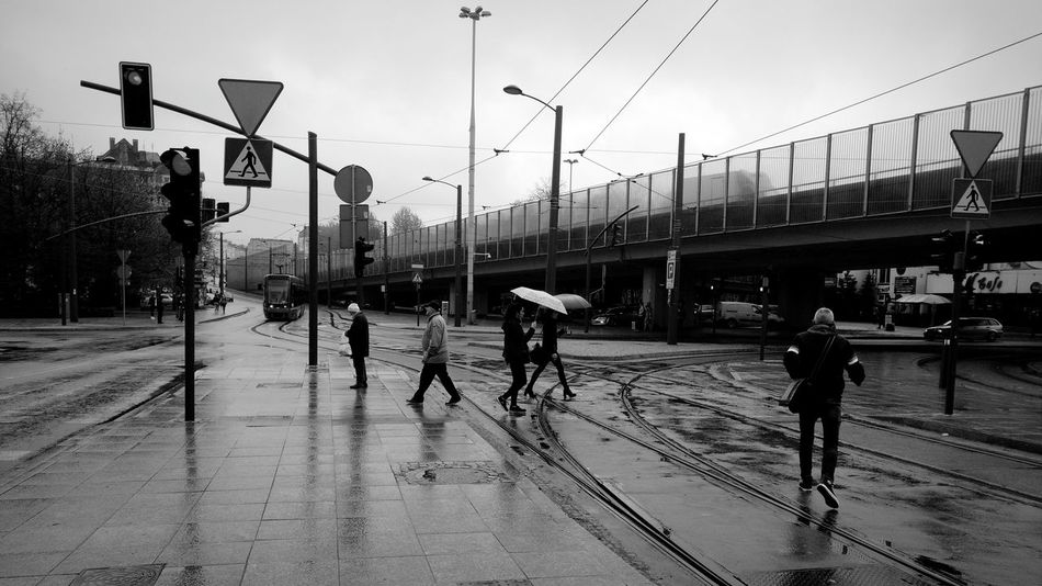 Outdoors Sky Real People Day Built Structure Large Group Of People Adults Only People Adult Street Photography Streetphoto_bw Black And White Black & White Mobile Photography From My Point Of View Wasiak Tram Tramway Tram Tracks Tram Station  Walkside Rain Rainy Days Moto X Play The Street Photographer - 2017 EyeEm Awards