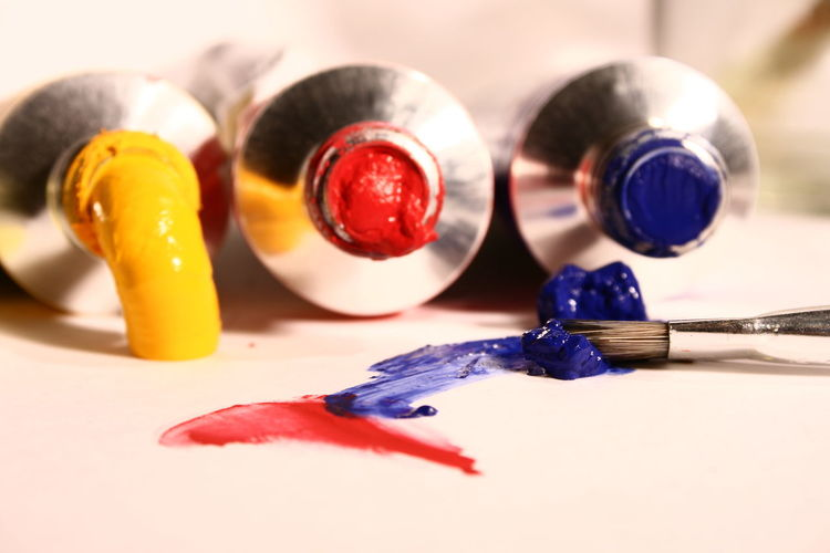 Close-up of colorful paint tubes on table