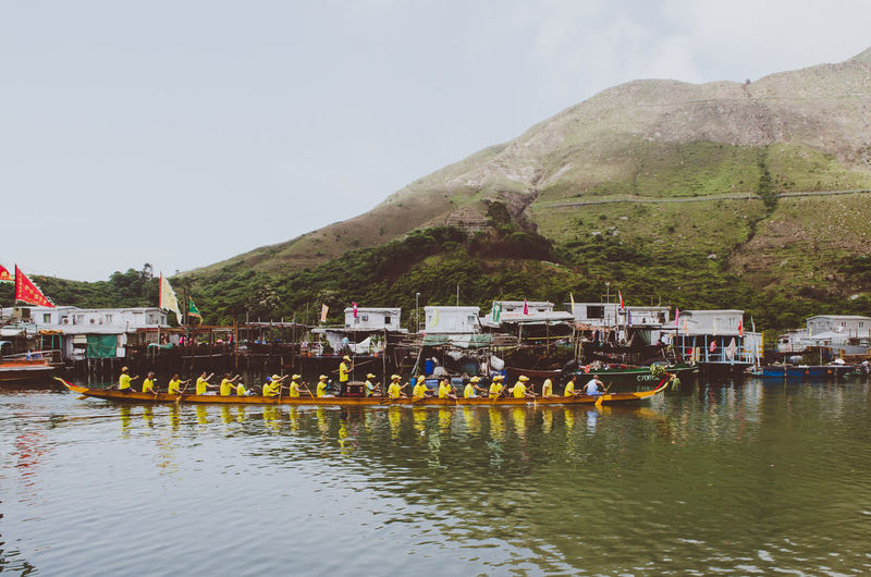 Dragonboat team Day Dragon Boat Festival Dragonboat Dragonboat Festival Hong Kong Large Group Of People Men Mountain Nautical Vessel Outdoors Paddling Paddling Boat Real People Tai O Tai O Village Team Transportation Water Waterfront