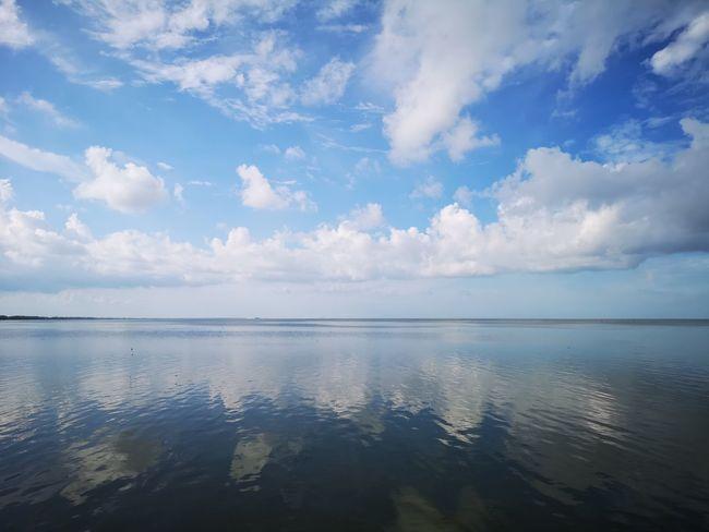 blue sky mirror Water Sea Blue Reflection Summer Idyllic Dramatic Sky