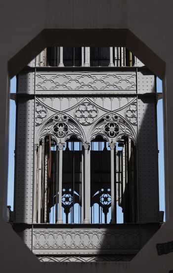 View of the of Santa Justa elevator trhouth frame - Lisbon, Portugal Arch Architectural Column Architecture Art And Craft Building Building Exterior Built Structure Closed Day Door Entrance Gate History Low Angle View No People Ornate Outdoors Pattern The Past Travel Destinations Window Wrought Iron