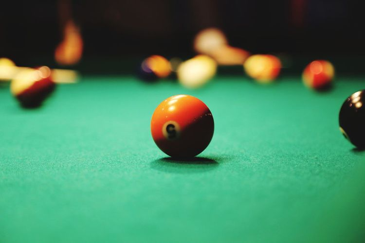 Close-up of cue balls on pool table