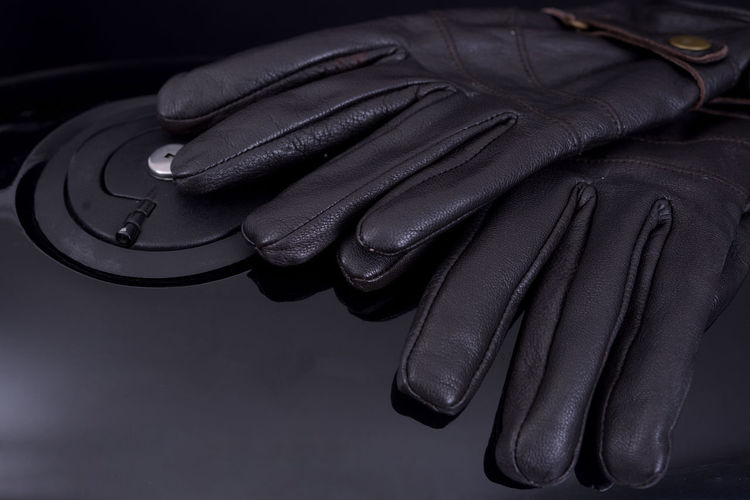Motorcycle R750CC Absence Black Black Color Classic Motorcycles Close-up Detail Focus On Foreground Glove Gloves High Angle View Indoors  Jacket Leather Motorbike Motrobiker Music Musical Instrument No People Protection Side By Side Still Life Studio Shot Table Textile