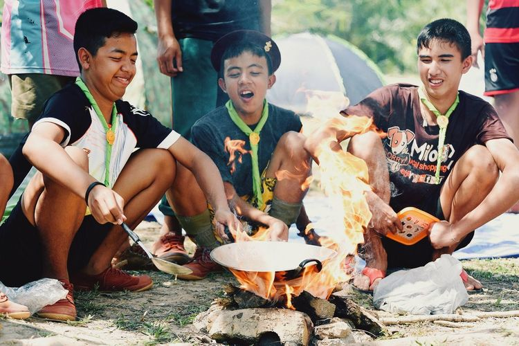 Scout camping Friends Happy Cooking Boyscouts Boy Scouts Education Thailand Group Of People Sitting Men Friendship Males  Happiness Togetherness Child Food And Drink Real People Adult Food Leisure Activity Emotion Fun Childhood Smiling Lifestyles Casual Clothing Teenager