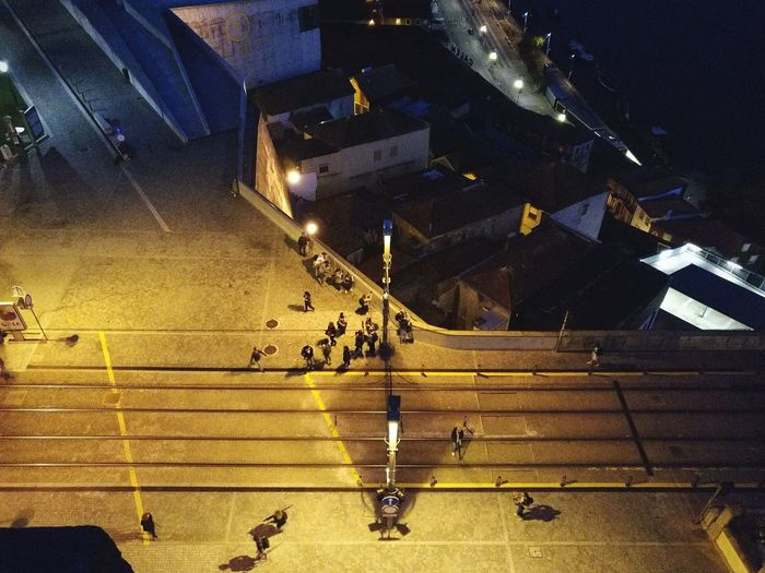 High angle view of people on road at night