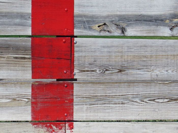 Weathered Red Paint Stripe on Wood Red Stripe HockeyRink Backgrounds Built Structure Close-up Full Frame No People Outdoors Pattern Red Red Paint Textured  Wood Wood - Material Wood Grain Weathered Protection Security Safety Textured  Wall - Building Feature Plank
