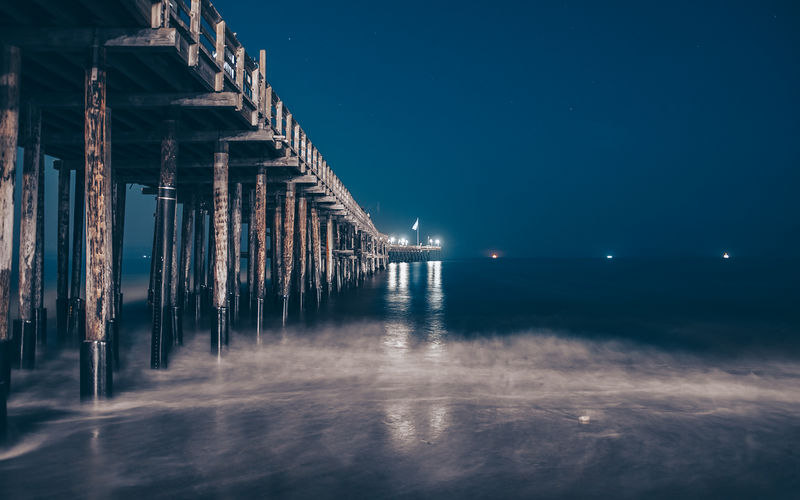 The Boardwalk Sky Water Waterfront Architecture Sea Built Structure No People Night Nature Illuminated Scenics - Nature Wood - Material Tranquil Scene Beauty In Nature Tranquility Land Outdoors Beach Reflection Architectural Column Wooden Post
