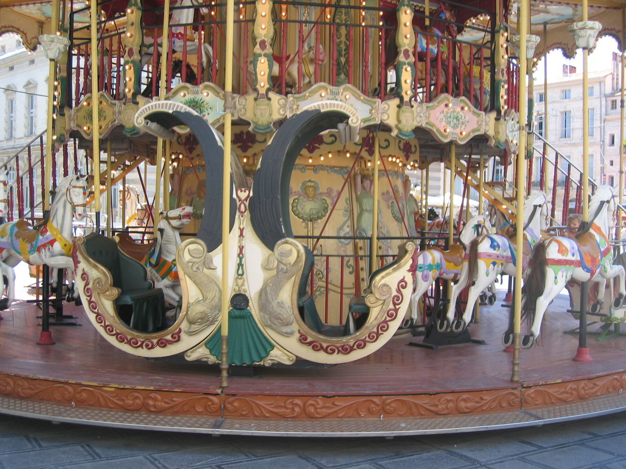 amusement park, amusement park ride, carousel, arts culture and entertainment, no people, representation, animal representation, art and craft, carousel horses, indoors, absence, creativity, multi colored, close-up, day, focus on foreground, architecture, illuminated, merry-go-round, ornate