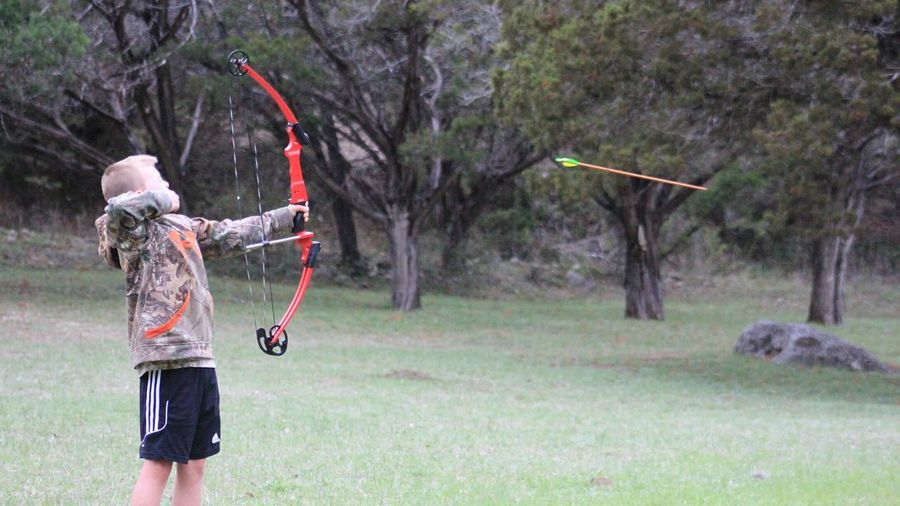 One Person Outdoors Nature Archery Bow And Arrow Arrow Freeze Frame