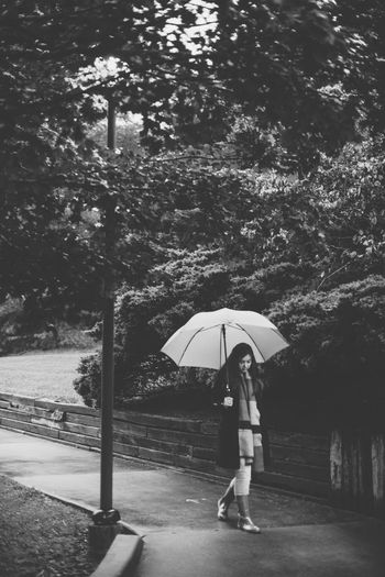 Black And White Full Length Nature One Person Outdoors Rain Real People Tree Under Water Wet First Eyeem Photo