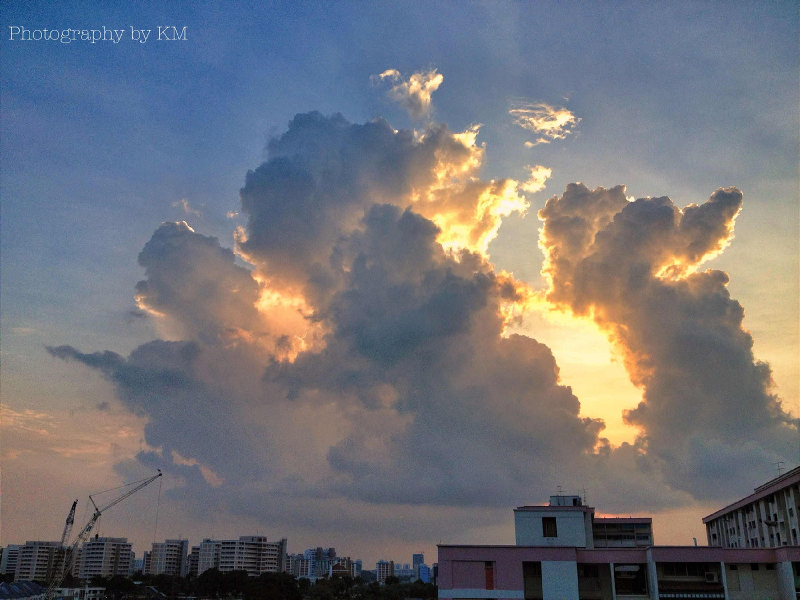 building exterior, architecture, built structure, sky, cloud - sky, sunset, cloudy, residential building, city, residential structure, weather, cloud, low angle view, dramatic sky, house, building, overcast, nature, beauty in nature, orange color
