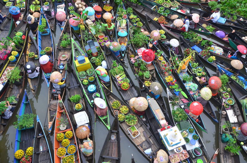 High angle view of decorations hanging in market for sale