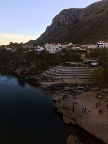 Balkan Bosnia And Herzegovina Evening Light Mostar Mostar Bosnia Mostar Bridge Mostar ♥ Old Town Tourist Attraction  Balkans Beauty In Nature Clear Sky IPhoneography Illuminated Mountain Neretva Neretva River Outdoors River Side Travel Destinations View From Above