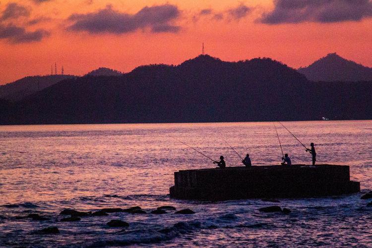 friends fishing