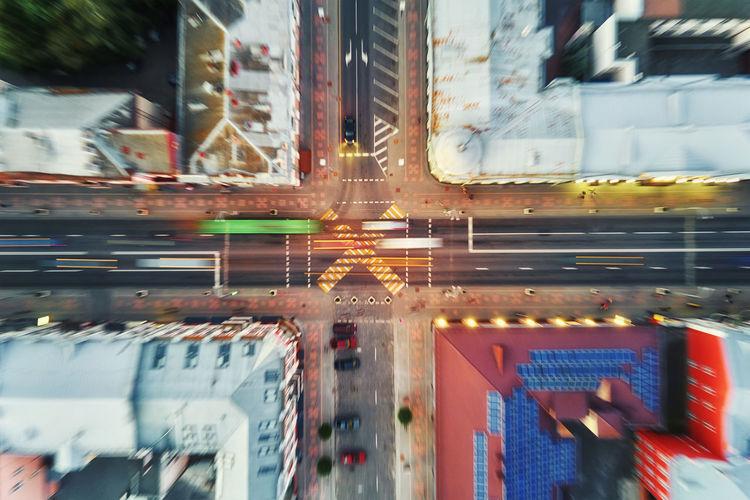 Illuminated city street by building