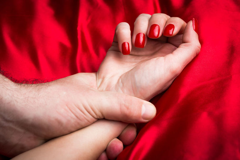 Young couple holding hands sensually on red silk bed. Adult Couple Emotions EyeEm EyeEm Best Edits EyeEm Best Shots EyeEm Selects EyeEm Gallery EyeEmBestPics EyeEmNewHere Holding Hands Love Valentine's Day  Couple - Relationship Enjoying Life Eye4photography  Eyeemphotography Holding Love Couple Passion Passionate Love Satin Sensory Perception Silk Valentine's Day - Holiday