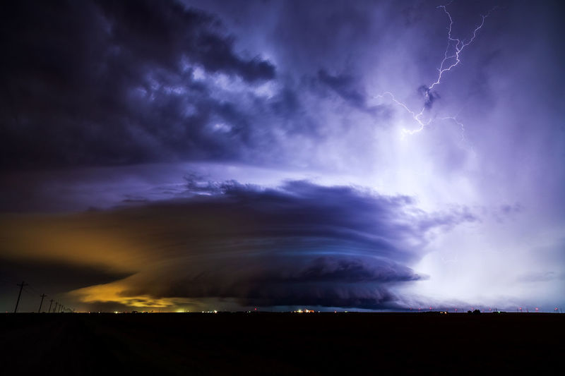Scenic view of lightning against sky during sunset