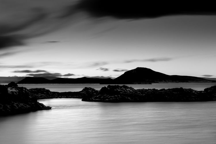 Lake Myvatn - Iceland Water Sky Scenics - Nature Tranquility Tranquil Scene Mountain Waterfront Beauty In Nature No People Cloud - Sky Nature Rock Idyllic Non-urban Scene Long Exposure Outdoors Day Iceland Landscape Rock Blackandwhite Beauty In Nature Black And White