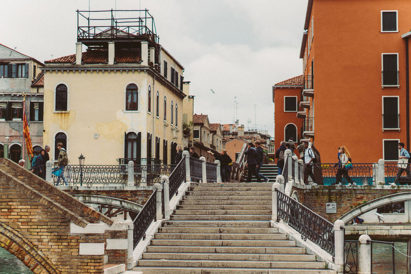 Venice Architecture Built Structure Building Exterior Staircase Railing Group Of People Real People Steps And Staircases Men Sky City Adult Lifestyles Building Women People Residential District Day Nature Cloud - Sky Outdoors Vertebrate