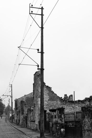 Oraduour Street Blackandwhite Power Line  Oradour Sur Glane Remember WWII Ruins No People Day Cable Sky Architecture