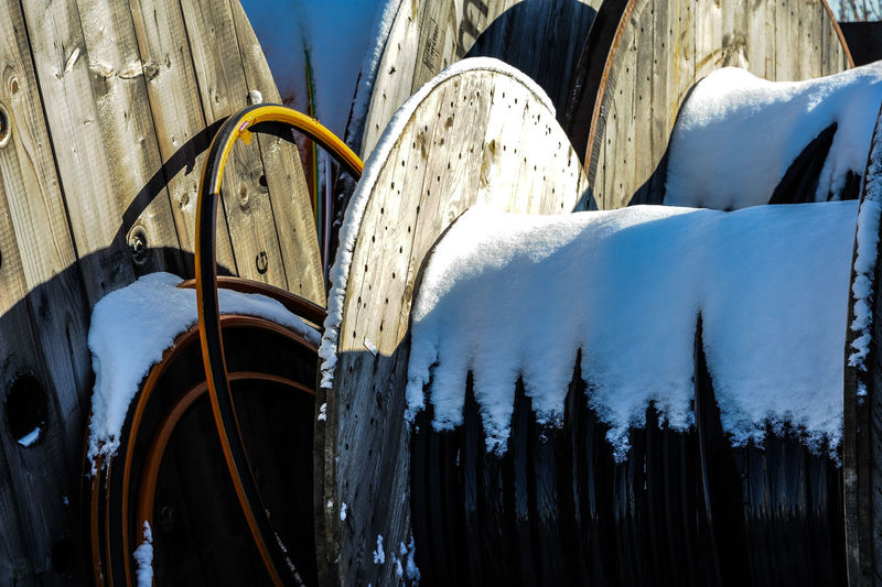 Close-up of icicles on snow covered landscape
